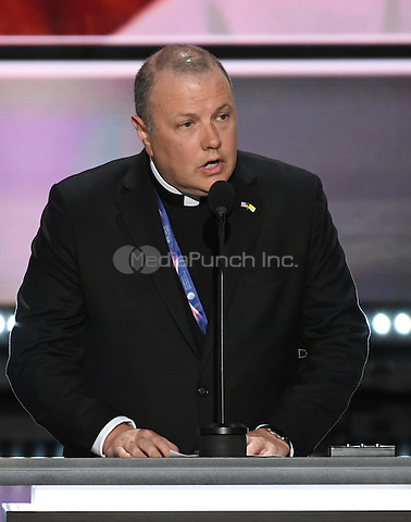 Monsignor Kieran Harrington of the Catholic Diocese of Brooklyn, New York delivers the invocation opening the evening session of the 2016 Republican National Convention held at the Quicken Loans Arena in Cleveland, Ohio on Monday, July 18, 2016.<br /> Credit: Ron Sachs / CNP/MediaPunch<br /> (RESTRICTION: NO New York or New Jersey Newspapers or newspapers within a 75 mile radius of New York City)