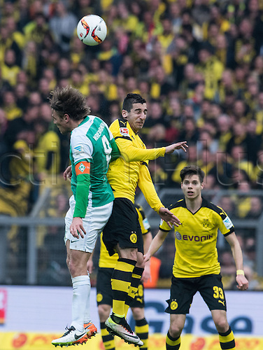 02.04.2016. Dortmund, Germany.  Dortmud's Henrikh Mkhitaryan (R) and Bremen's Clemens Fritz challenge for the header during the German Bundesliga match between Borussia Dortmund and Werder Bremen in Signal Iduna Park in Dortmund, Germany, 02 April 2016.