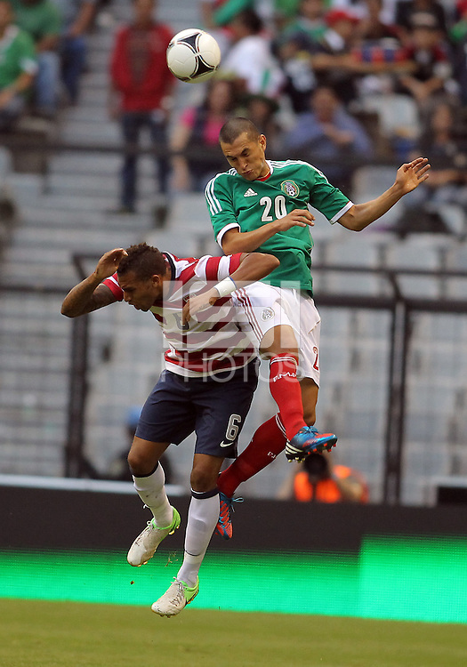 MEXICO CITY, MEXICO - AUGUST 15, 2012:  Danny Williams (6) of the USA MNT is beaten to a header by Jorge Torres Nilo (20) of  Mexico during an international friendly match at Azteca Stadium, in Mexico City, Mexico on August 15. USA won 1-0.