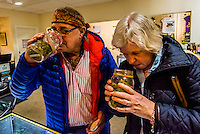 Seniors (Norwegian tourists) visiting the Sticky Buds Broadway marijuana dispensary, Denver, Colorado USA. About half of recreational marijuana sold in Colorado is bought by tourists.
