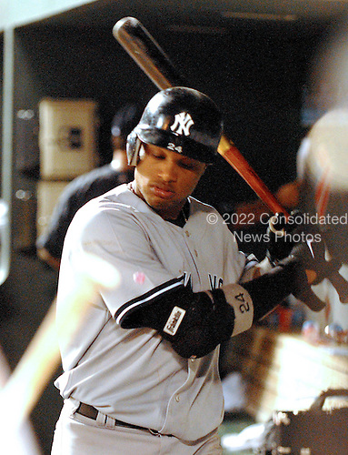 Baltimore, MD - June 27, 2007 -- New York Yankee second baseman Robinson Cano (24) takes a swing at a piece of bubble gum the dug-out following his team's 4 - 0 loss to the Baltimore Orioles at Oriole Park at Camden Yards in Baltimore, MD on Wednesday, June 27, 2007..Credit: Ron Sachs / CNP.(RESTRICTION: NO New York or New Jersey Newspapers or newspapers within a 75 mile radius of New York City)