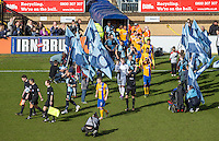 The Teams enter the field during the Sky Bet League 2 match between Wycombe Wanderers and Mansfield Town at Adams Park, High Wycombe, England on 25 March 2016. Photo by Andy Rowland.