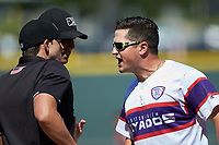 Winston-Salem Dash manager Justin Jirschele (9) argues with home plate umpire Steven Hodgins after having been ejected from the game against the Lynchburg Hillcats at BB&T Ballpark on June 23, 2019 in Winston-Salem, North Carolina. The Hillcats defeated the Dash 12-9 in 11 innings. (Brian Westerholt/Four Seam Images)