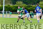 Aidan Cox Laune Rangers tackles Cathal Moriarty Milltown/Castlemaine during their Intermediate clash in Milltown on Sunday