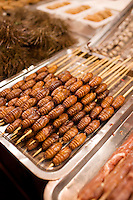 Deep fried silkworm skewers for sale in the Night Market, Wangfujing Street, Beijing, China
