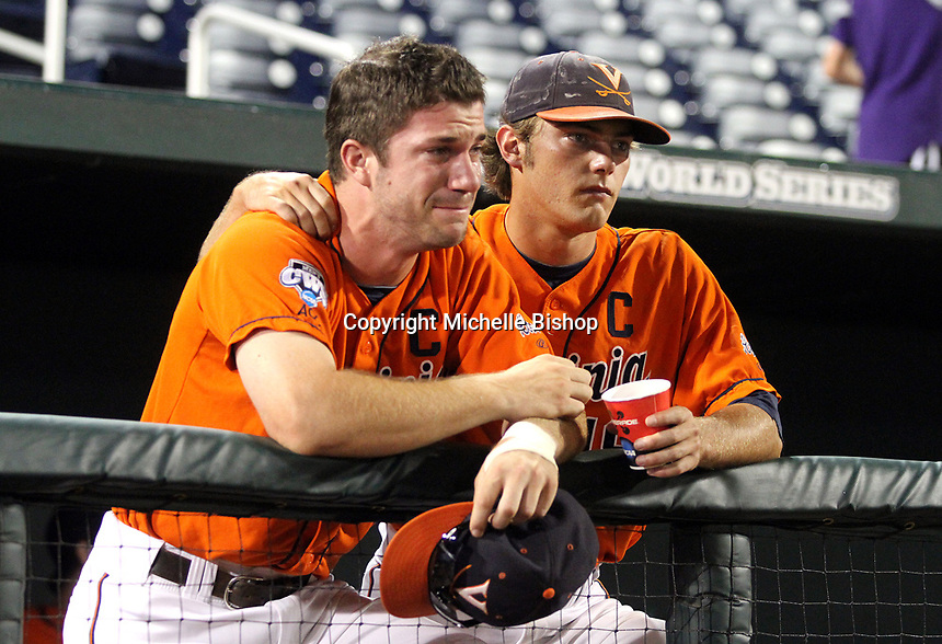 Virginia's Tyler Wilson consoles Tyler Biddix after the Cavaliers were eliminated from the College World Series. South Carolina beat Virginia 3-2 in 13 innings on June 24, 2011 in Omaha, Neb. (Photo by Michelle Bishop)..