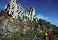The Queen's Palace caps the highest hill in Antananarivo, Madagascar. The main palace was built in 1867 for Queen Ranavalona II. In 1995, the building was gutted by arson. (1996)