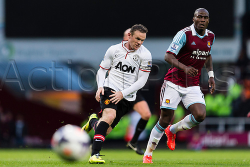 22.03.2014  London, England.   Manchester United's Wayne ROONEY makes a pass then sprints ahead for the return ball in the build-up leading to his second goal during the Premier League game between West Ham United and Manchester United from the Boleyn Ground, Upton Park .