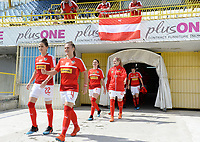 20190304 - LARNACA , CYPRUS : Austrian players with Jennifer Klein (22) and Viktoria Pinther (4)  pictured entering the pitch prior to a women's soccer game between Slovakia and Austria , on Monday 4 th March 2019 at the GSZ Stadium in Larnaca , Cyprus . This is the third and last game in group C for both teams during the Cyprus Womens Cup 2019 , a prestigious women soccer tournament as a preparation on the Uefa Women's Euro 2021 qualification duels. PHOTO SPORTPIX.BE | DAVID CATRY