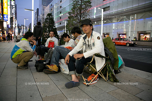 The first person on the line Mr Tamura from Ibaraki Prefecture waits in front of the Apple Store in Ginza since September 10, to buy the new iPhone 5s and lower-cost iPhone 5c, September 17, 2013. During the typhoon Man-yi, the 18th of the season, lashes on Japan this September 16, 2013, Apple fans waited inside the store to protect of the powerful typhoon. According to Apple the mobile phones will be available in Japan, U.S. and other seven countries from September 20. (Photo by Rodrigo Reyes Marin/AFLO)