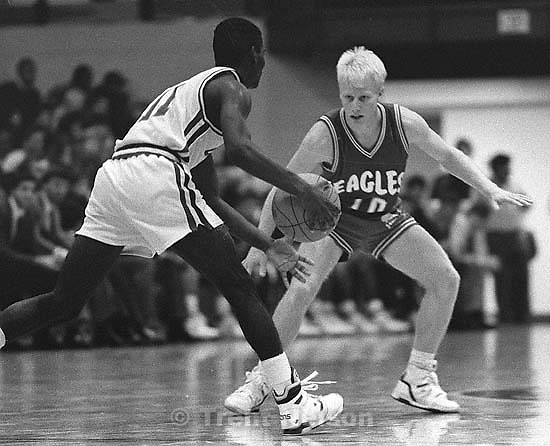 Ronn McMahon (#10) playing basketball. Eastern Washington vs. San Jose State.<br />