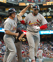 Albert Pujols of the St. Louis Cardinals, right, is congratulated by teammate Scott Spiezio after Pujols hit a three-run home run against the San Francisco Giants at At&T Park in San Francisco Tuesday May 23, 2006. (Alan Greth/Contra Costa Times)