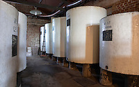 cylindrical concrete fermentation tanks painted in white and black. Bodega Pisano Winery, Progreso, Uruguay, South America
