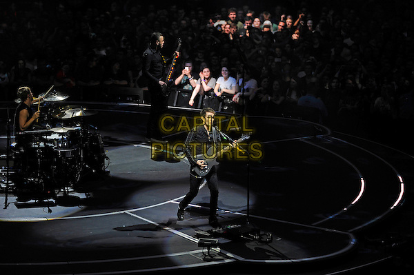 LONDON, ENGLAND - APRIL 3: Matt Bellamy, Dominic Howard, Chris Wolstenholme of 'Muse' performing at the O2 Arena on April 3, 2016 in London, England.<br /> * Press use only. No merchandising *<br /> CAP/MAR<br /> &copy;MAR/Capital Pictures