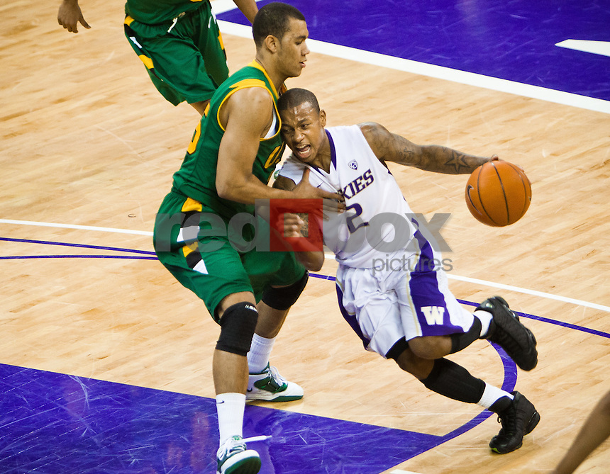 Isaiah Thomas, guard, currently with the Sacramento Kings of the NBA - Washington Huskies men's basketball against University of San Francisco Dons at Hec Edmundson Pavilion in Seattle on Saturday, December 18, 2010. (Photo by Dan DeLong/Red Box Pictures)