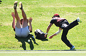6th December 2017, Eden Park, Auckland, New Zealand; Ford Trophy One Day Cricket, Auckland Aces versus Canterbury Wizards;  Jeremy Benton dives over the boundary as a fan takes evasive action