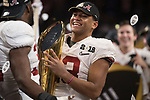ATLANTA, GA - JANUARY 08: Tua Tagovailoa #13 and Rashaan Evans #32 of the Alabama Crimson Tide celebrates after defeating the Georgia Bulldogs during the College Football Playoff National Championship held at Mercedes-Benz Stadium on January 8, 2018 in Atlanta, Georgia. Alabama defeated Georgia 26-23 for the national title. (Photo by Jamie Schwaberow/Getty Images)