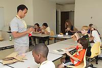 New York, NY, USA - June 23, 2012: Swiss designer, Sipho Mabona teaches a class how to fold his original design, a complex origami bear.