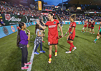 Portland, Oregon - Wednesday June 22, 2016: Portland Thorns FC forward Christine Sinclair (12) high fives the girls of the game after receiving roses for scoring a goal during a regular season National Women's Soccer League (NWSL) match at Providence Park.