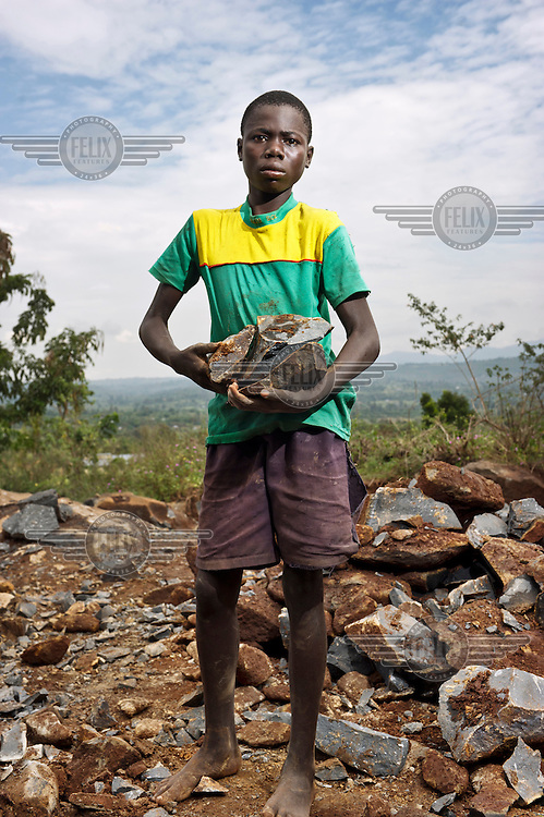A portrait of Dancun, who works as a ballast cutter. He breaks up stones into ballast to be used in concrete on construction sites in town.