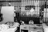 February 3rd 1968 Cummins, Arkansas, USA Inmates rest in the large communal room at the Cummins unit of Arkansas State Penitentiary. The corruption scandal of the historical penitentiary inspired the 1980 film Brubaker, which chronicled the warden's inside investigation into the corrupt southern prison system. <br />