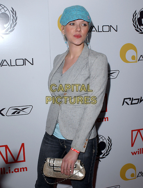 SCARLETT JOHANSSON.Will.i.am Music Group and RBK's Tsunami Relief Benefit Concert held at Avalon in Hollywood, California .February 11th, 2005.half length silver clutch purse grey gray jacket blue hat.www.capitalpictures.com.sales@capitalpictures.com.Supplied By Capital PIctures