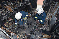 Fire investigation officers searching for clues as to the cause of a severe school fire UK. This image may only be used to portray the subject in a positive manner..©shoutpictures.com..john@shoutpictures.com