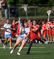 Corey Donohoe (7) of North Carolina tries to get past Kate Ivory (7) of Cornell at St. Stephens and St. Agnes High School in Alexandria, VA.  North Carolina defeated Cornell, 13-7.
