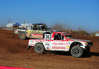 Apr 17, 2011; Surprise, AZ USA; LOORRS driver Rodrigo Ampudia (36) leads Kyle Leduc (99) during round 4 at Speedworld Off Road Park. Mandatory Credit: Mark J. Rebilas-