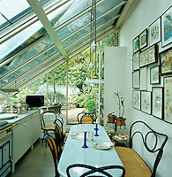 The kitchen is situated in a conservatory which is an addition to the top storey of the converted printworks and leads onto a private rooftop garden