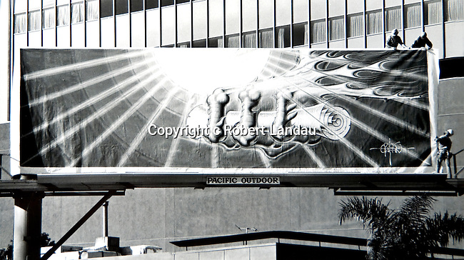 Installation of Rick Griffin billboard on Wilshire Blvd. in Los Angeles for Eyes and Ears Foundation project in 1976