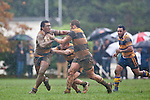 Viliame Fihaki tries to fend off the tackle of Mike McKinnon and Conall Bromwich. Counties Manukau Premier Club Rugby game between Patumahoe and Bombay played at the Patumahoe Domain on Saturday June 4th 2011 as part of the Patumahoe 125th Anniversary celebrations. Patumahoe won 24 - 3 after leading 5 - 3 at halftime.