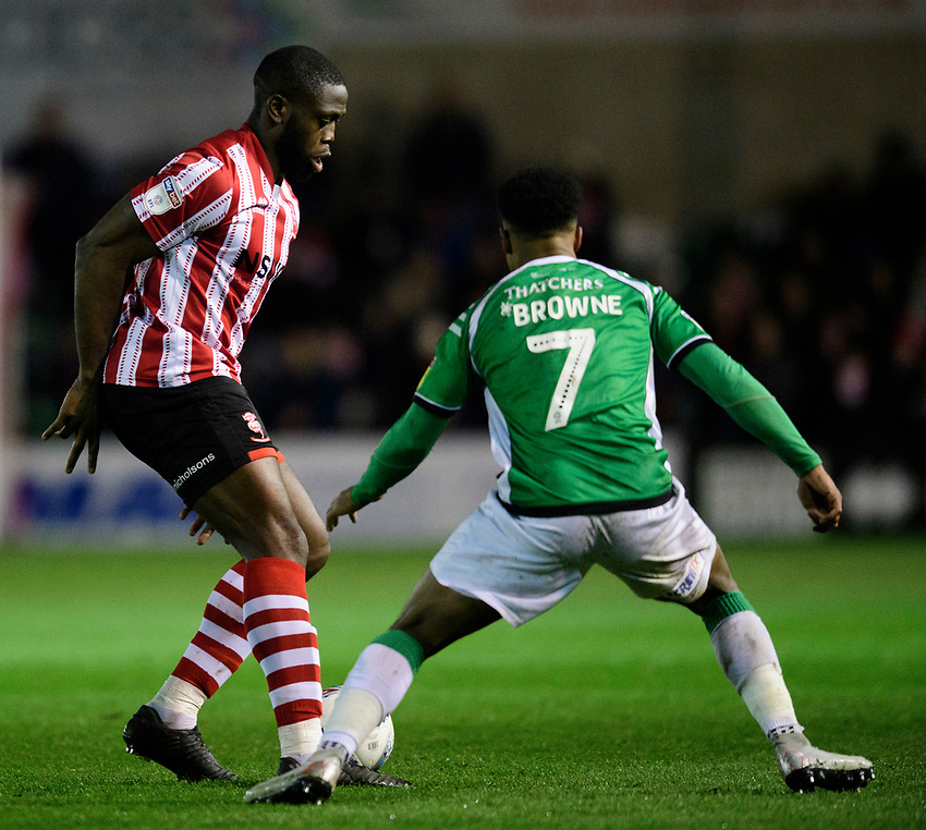 Lincoln City's John Akinde vies for possession with Yeovil Town's Rhys Browne<br /> <br /> Photographer Chris Vaughan/CameraSport<br /> <br /> The EFL Sky Bet League Two - Lincoln City v Yeovil Town - Friday 8th March 2019 - Sincil Bank - Lincoln<br /> <br /> World Copyright © 2019 CameraSport. All rights reserved. 43 Linden Ave. Countesthorpe. Leicester. England. LE8 5PG - Tel: +44 (0) 116 277 4147 - admin@camerasport.com - www.camerasport.com