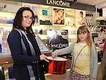 Julieanne Kieran and Abby McCoy pick the winning tickets in the Lancome draw at McGoey pharmacy Ardee celebrating 12 years in business. Photo: Colin Bell/pressphotos.ie