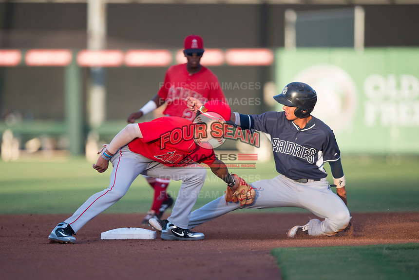 AZL Angels shortstop Jeremiah Jackson (8) applies the tag to Tucupita Marcano (1) on a stolen base attempt during an Arizona League game against the AZL Padres 2 at Tempe Diablo Stadium on July 18, 2018 in Tempe, Arizona. The AZL Padres 2 defeated the AZL Angels 8-1. (Zachary Lucy/Four Seam Images)