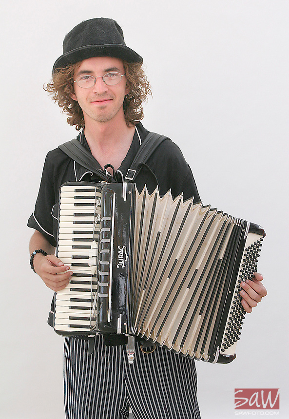 BLACK ROCK CITY,NV - AUGUST 29, 2008:  Ilya Kramer, 24, brought his accordian for his 2nd burn. Kramer is spending the week at Burning Man. Photographed at center camp, August 29, 2008.