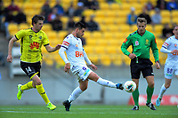 Perth's Bruno Fornaroli controls the ball under pressure from Alex Rufer (left) during the A-League football match between Wellington Phoenix and Perth Glory at Westpac Stadium in Wellington, New Zealand on Sunday, 27 October 2019. Photo: Dave Lintott / lintottphoto.co.nz