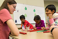 """NWA Democrat-Gazette/CHARLIE KAIJO Madelyn Bertrand (left) helps kids write a haiku during the """"How-To"""" festival, Saturday, March 24, 2018 at the Bentonville Library in Bentonville. <br /><br />Participants learned how to create a Duck Tape® corner bookmark, design a balloon rocket racer, discover finger knitting, write a Haiku poem, paint a watercolor masterpiece and learn about BookFlix®"""
