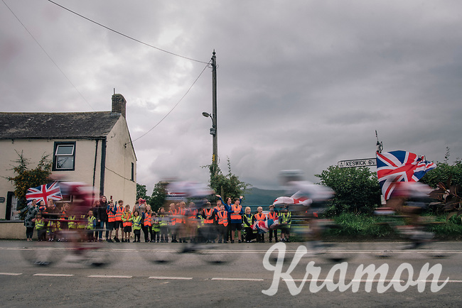 breakaway group speeding by some very enthusiastic kids<br /> <br /> Racing in/around Lake District National Parc / Cumbria<br /> <br /> Stage 6: Barrow-in-Furness to Whinlatter Pass   (168km)<br /> 15th Ovo Energy Tour of Britain 2018