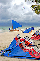 Action on a windy day in Boracay, Philippines, windsufers and kite boarding at the beach.
