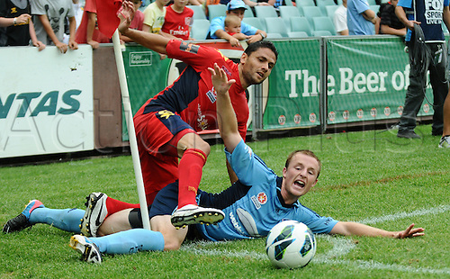 16.02.2013 Sydney, Australia.Adelaides Argentine midfielder Marcelo Carrusca and Sydney midfielder Rhyan Grant in action during the Hyundai A League game between Sydney FC and Adelaide United from the Allianz Stadium.