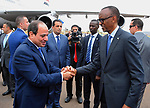 Egyptian President Abdel Fattah al-Sisi shakes hands with Rwandan President Paul Kagame after al-Sisi's arrival at Kigali International Airport on August 15, 2017. The Egyptian President is paying a two day visit to Rwanda. Photo by Egyptian President Office