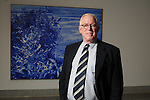 Barry Walker, MFAH curator of modern and contemporary art and prints and drawings, in front of Mark Tansey's Apple Tree in the Beck Building of the Museum of Fine Arts Monday Aug. 08,2011.(Dave Rossman/For the Chronicle)