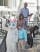 United States President Barack Obama and First Lady Michelle Obama, along with their dogs Bo and Sunny walk down the South Portico steps to participate in the White House Easter Egg Roll on the South Lawn of the White House in Washington, D.C. on Monday, April 21, 2014.<br /> Credit: Ron Sachs / CNP