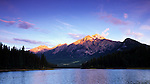 The sunrise as seen from Pyramid Lake with Pyramid Mountain in the distance in Jasper National Park, Alberta, Canada.