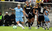 Kelly Parker (7) of Sky Blue evades midfielders Aya Miyama (8) and Shannon Boxx (7) of the LA Sol.  Sky Blue played to a 0-0 tie against the LA Sol Saturday, June 13, in Piscataway, NJ.