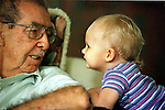 Eighty-one year old Fred Flores gets to know his great grandaughter Rachel Wages a little better when he visited her in Houston shortly after Rachel's first birthday. (Steve Campbell/Houston Chronicle)