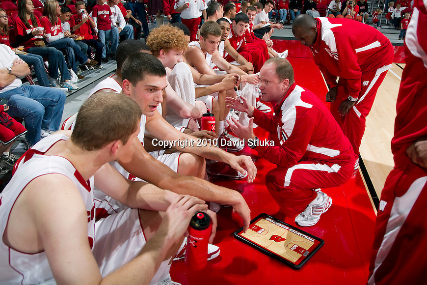 Wisconsin Badgers assistant coach Greg Gard talks to the white team during an NCAA red/white basketball team scrimmage at the Kohl Center on October 24, 2010 in Madison, Wisconsin. (Photo by David Stluka)