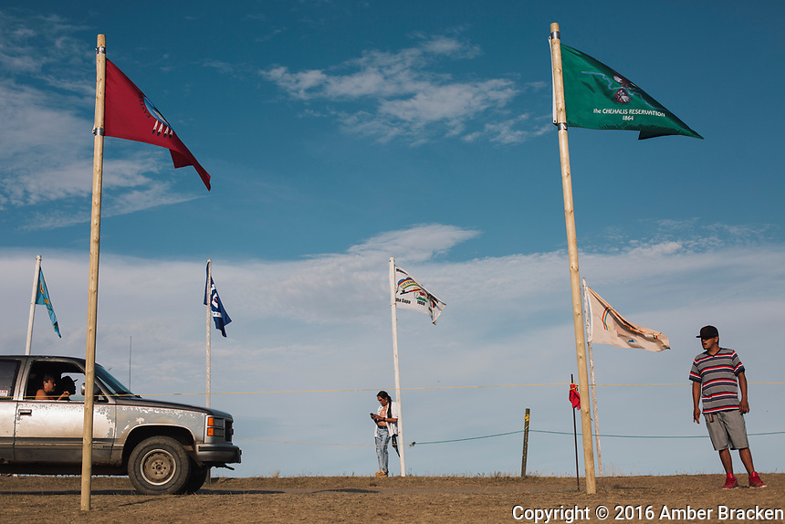 The flags at Sacred Stone camp are each brought by tribes as they arrive near Cannonball, ND on Sunday, September 11, 2016.  Organizers say there are over 220 tribes represented.
