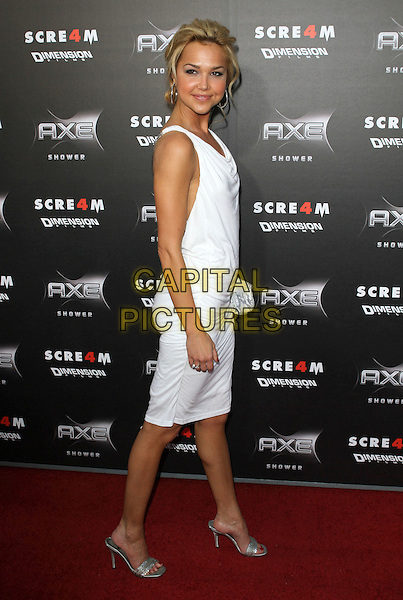 "ARIELLE KEBBEL.""Scream 4"" Los Angeles Premiere Held At The Grauman Chinese Theatre, Hollywood, California, USA..April 11th, 2011.scre4m full length white dress clutch bag open toe silver shoes sandals side.CAP/ADM/KB.©Kevan Brooks/AdMedia/Capital Pictures."